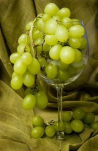 White Grapes in Wine Glass